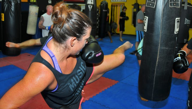 Michelle Mulak, FLORIDA TODAY fitness & water reporter, tries her hand  - and feet- in a core kickboxing class taught by instructor David DiQuollo, owner of Unlimited Kickboxing on Merritt Island.