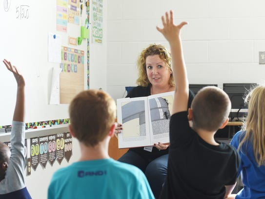 Trudi Hardcastle reads to her students at Zanesville's