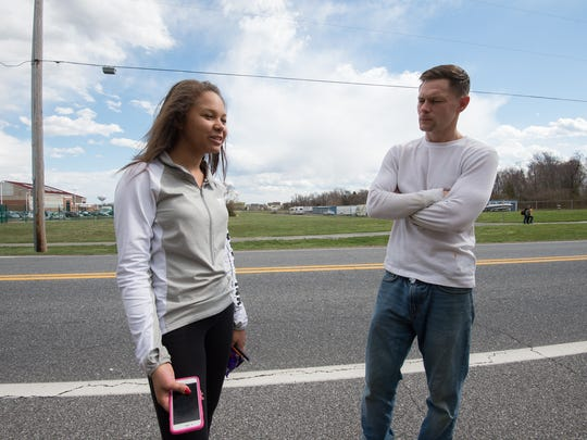 Asia Jones (13) a seventh grade student at Smyrna Middle School and her father Jeremy Kokotaylo talk with a News Journal reporter concerning the arrest of Smyrna High School teacher Joshua Rutherford.