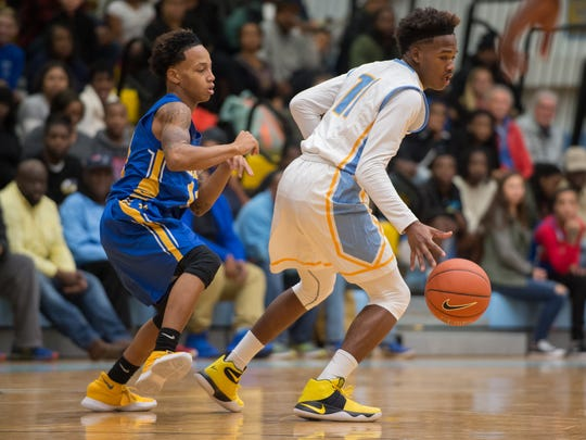 Cape Henlopen's Sh'Kai Chandler (11) dribbles the ball down the court in their home game against Caesar Rodney.