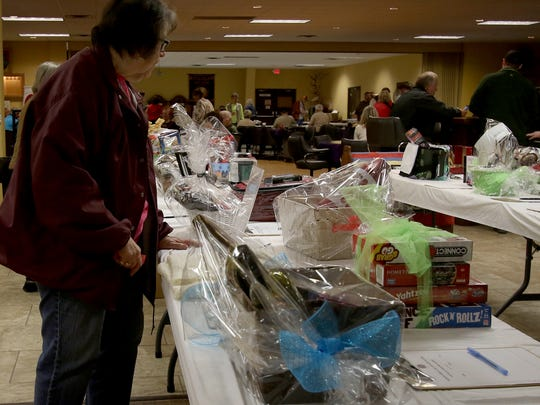 People browse the silent auction during Sheriff Duke's