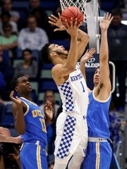 FILE - In this Saturday, Dec. 23, 2017, file photo, Kentucky forward Sacha Killeya-Jones (1) shoots over UCLA guard Kris Wilkes (13) and forward Alex Olesinski (0) in the first half of an NCAA basketball game in New Orleans. Improved balance has created the possibility of a more unpredictable race for the title as the Southeastern Conference gets ready to begin league competition. Traditional powers Kentucky and Florida haven't fared as well as usual in nonconference play, while the rest of the league has stepped up its performance. (AP Photo/Scott Threlkeld, File)