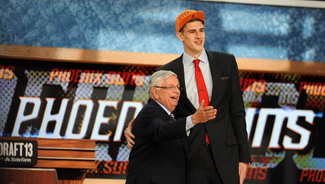 Jun 27, 2013: Alex Len (Maryland) poses for a photo with NBA commissioner David Stern after being selected as the number five overall pick to the Phoenix Suns during the 2013 NBA Draft at the Barclays Center.