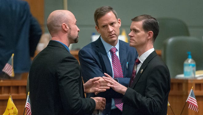 Rep. Bill McCamley, D-Mesilla Park, from left, House Majority Leader Nate Gentry, R-Albuquerque, and Rep. Jason Harper, R-Rio Rancho, were among the House members trying to work out a bill during the fourth day of the special session on Monday, Oct. 3, 2016, in Santa Fe.