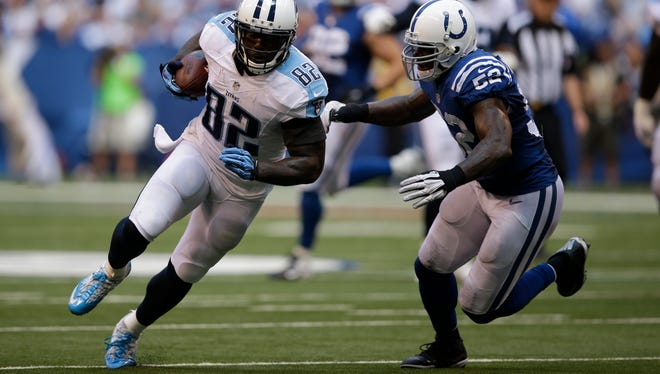 Tennessee Titans tight end Delanie Walker, left, is hit by Indianapolis Colts inside linebacker D'Qwell Jackson during the second half of a game Sunday in Indianapolis.