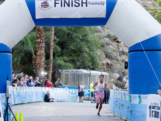 Tram Road Challenge Men's overall winner Mario Macias crossing the finish line