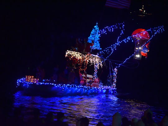 File 2015: Boats from the Isles of Capri displayed exuberant decoration. Brightly lit craft cruised local waterways Saturday evening in Marco's Christmas Island Style Boat Parade, joined by boats from the Isles of Capri parade. Lance Shearer/Eagle Correspondent