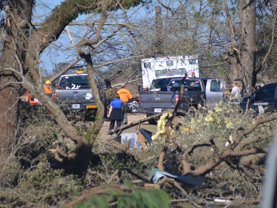 Multiple state agencies search the debris of Piney Wood Estates mobile home park in east Albany for missing two year old Detrez Green who went missing during Sunday's deadly tornado. (Staff Photo: Jon Gosa)