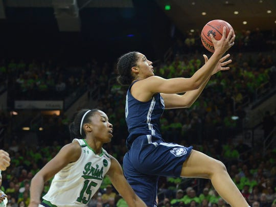 Gabby Williams drives to the basket in a game against Notre Dame.