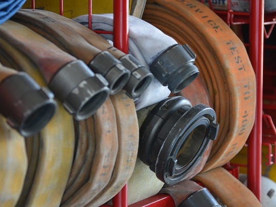 Fire hoses sit coiled and ready for use in this file