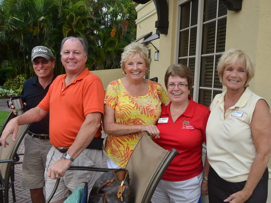 Stan Niemczyk, second from left, volunteering at a Christmas Island Style golf tournament. NIemczyk was named Marco Island Volunteer of the Year at the chamber of commerce gala Sunday night. Lance Shearer/Special to the Naples Daily News