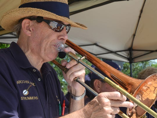 Marco Island Strummers bandleader Wes English plays for a Memorial Day ceremony at Veterans' Community Park.