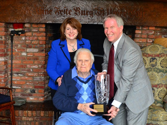 Carson-Newman University President Randall O'Brien and his wife, Kay, present the Rev. Billy Graham with the Evangelist of the 20th Century Award. O'Brien will step down as C-N president in December, and the university is searching for his replacement.