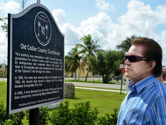 In this June 2013 file photo, Everglades City Mayor Sammy Hamilton reads the plaque he just unveiled, lauding his preservation of City Hall.