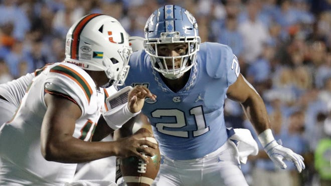 North Carolina linebacker Chazz Surratt, shown here chasing Miami quarterback Jarren Williams during a game last year, has cross-trained to be in position to produce more pressure this season.