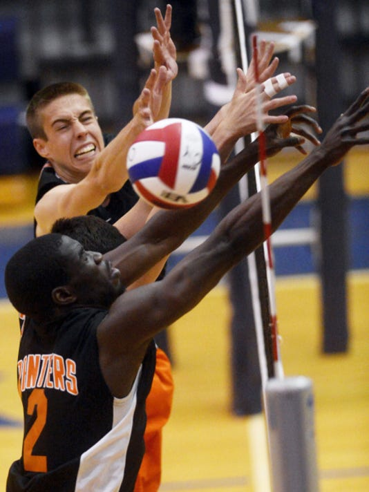 From top, Central York's Landon Shorts, Hayden Wagner, and Jeremiah Dadeboe can't block a kill from Penn Manor's during the District 3 Class AAA boys' volleyball championship game at Dallastown Area High School on Friday. The Panthers won, 3-2.