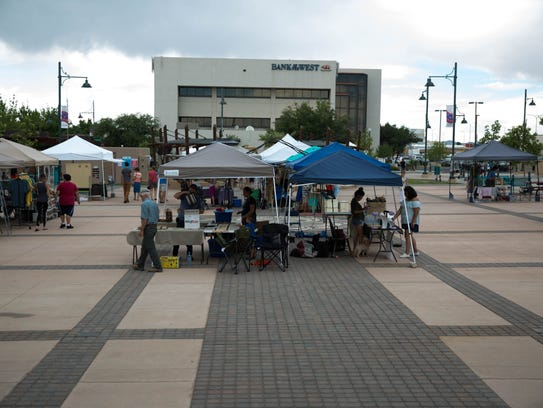 Vendors set up booths on Plaza de Las Cruces before