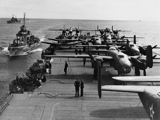 PACIFIC OCEAN 1942 -- Some of the B-25 Mitchells of the Doolittle Raiders crowd the rear deck of the USS Hornet with two escort vessels following close in the background. The B-25s took up most of the deck space of the USS Hornet, so the Navy fighters were stored below on the hangar deck. The USS Enterprise (not seen) provided fighter cover for the task force. The Doolittle Raid, U.S. Army Air Force special order #1 of World War II, was a daring one-way mission of 16 B-25 Mitchell medium bombers with 80 aircrew, commanded by Lt. Col. James ?Jimmy? Doolittle, to carry out America?s first offensive attack on Japan. (Photo courtesy National Museum of the U.S. Air Force)