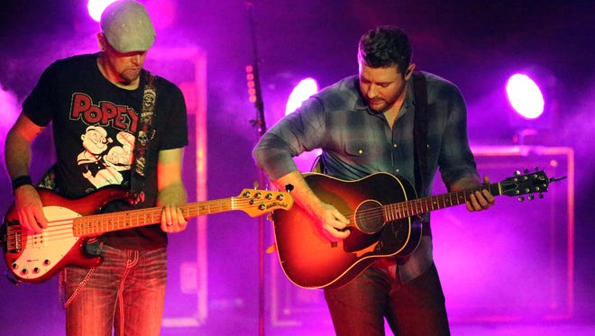 Country music artist Chris Young, right.