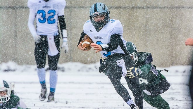 Lansing Catholic's Tony Palmer, center,  is one of five mid-Michigan seniors that will play in the MHSFCA East-West all-star game Saturday at Saginaw Valley.