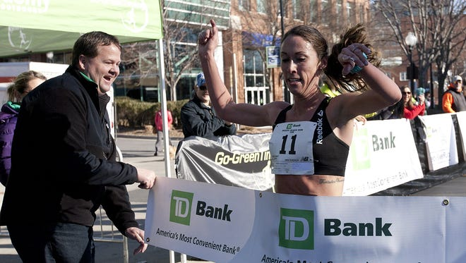 Sarah Crouch from North Carolina was the first woman finisher in the 10K event during the TD Bank Reedy River Run presented by The Greenville News in 2015..