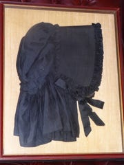 """An heirloom """"mourning bonnet"""" that belonged to either Georgiann Potts' great-aunt or great-grandmother. It is approximately 175 years old and has been passed down in the family through Georgiann's material line."""