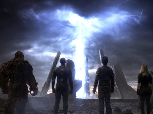 "This photo provided by courtesy Twentieth Century Fox shows, The Thing, from left, Michael B. Jordan as Johnny Storm, Miles Teller as Dr. Reed Richards, and Kate Mara as Sue Storm, in a scene from the film, ""Fantastic Four,"" releasing in U.S. theaters on Aug. 7, 2015. (Twentieth Century Fox via AP)"