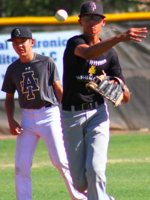Alamogordo freshman shortstop Rooster Williams makes a throw to first base during practice Tuesday afternoon at Tiger Field.