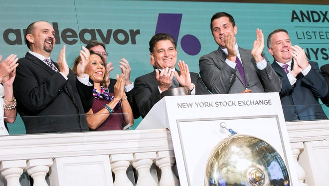 Andeavor CEO Greg Goff, center, claps after ringing the opening bell Tuesday at the New York Stock Exchange to celebrate the name change for Tesoro Corp.