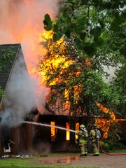 Fire crews work in vain to control a fire that broke