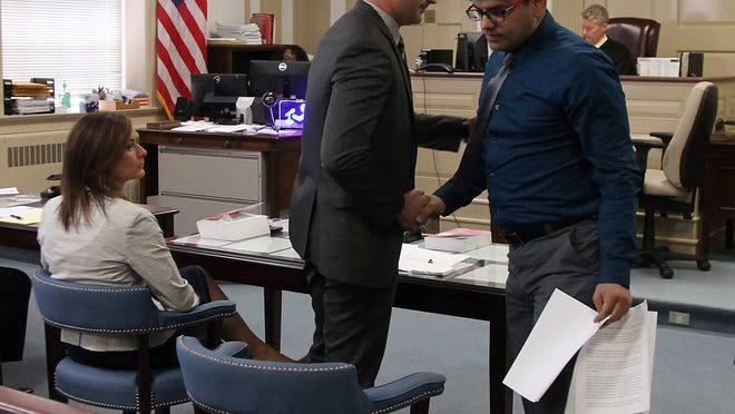 Assistant Prosecutor Matthew Troiano shakes the hand of Nazish Noorani's brother, Kaleem after he gave a victim impact statement at the sentencing of Kashif Parvaiz who got life in state prison, plus 10 years, for the murder of his wife, Nazish Noorani, shot to death on a Boonton street in 2011.