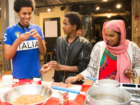"""""""Soo Fariista/Come Sit Down: A Somali American Cookbook"""" features traditional Somali family recipes with a modern Minnesota twist. The cookbook was authored by Somali high school students who participated in the Minnesota Historical Society program """"Wariyaa: Somali Youth in Museums"""" in 2016. Students interviewed family members, collected recipes and stories, researched techniques and ingredients and tested recipes at the Mill City Museum Baking Lab.  The """"Somalis + Minnesota"""" exhibit opens June 23, 2018 at the Minnesota History Center."""