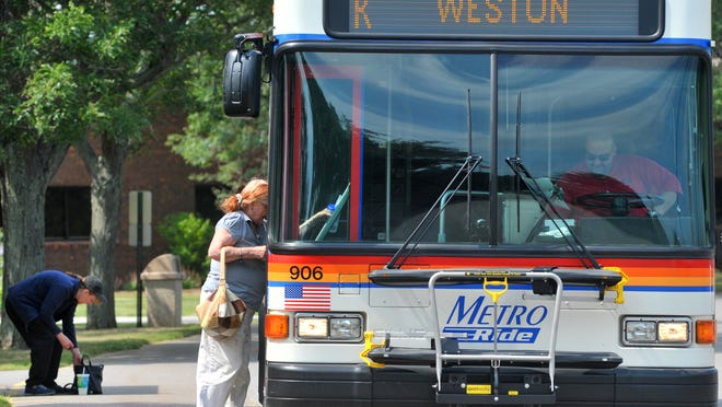 A Metro Ride bus picks up riders July 21 at North Central Health Care in Wausau. The Weston Village Board Monday gave final approval to a referendum that will ask voters if the village should raise the tax levy by $60,000 to fund the bus route.