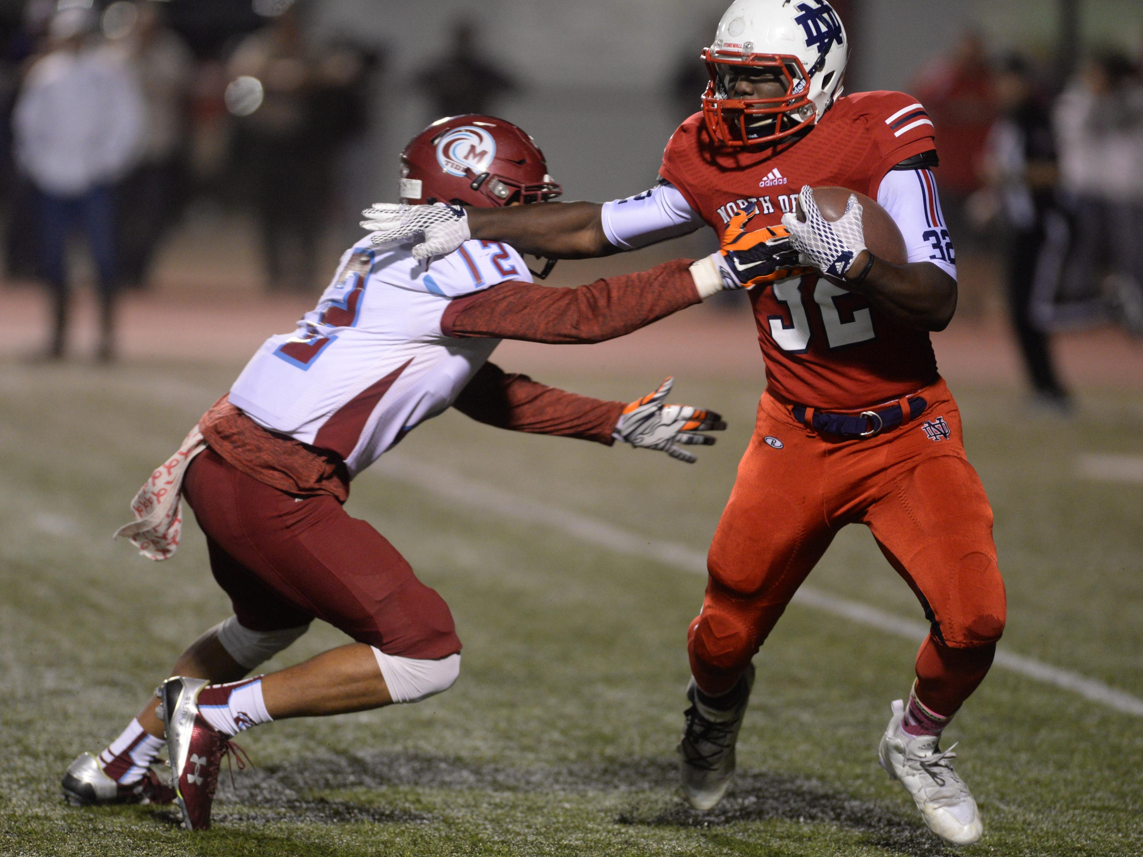 Minden's Tychrisopher Harris gets his hands on DElmonte Hall of North DeSoto.