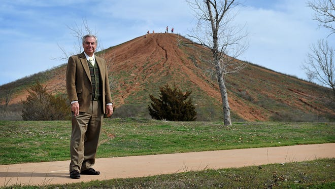 Jack Murphy, director of the Wichita Falls Parks and Recreation Department, stands at Lake Wichita Park, the location of an 80-foot-tall mound of dirt commonly referred to as Mount Murphy. The hill was the result of an excavation project of Sikes Lake. Murphy is retiring after more than three decades with the city.