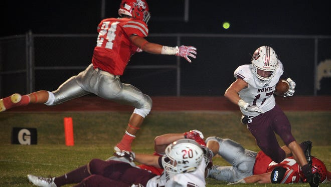 Bowie's Rylan Dorman (17) is tripped up by Holliday's Tanner Bayard (55) and Tristan Boyd (24) in first-half action Friday.