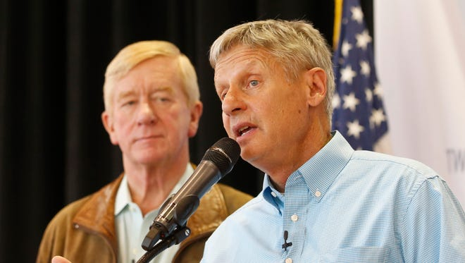 Gary Johnson, right, and Bill Weld talk to reporters in Salt Lake City.
