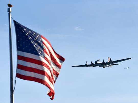 A WWII era plane flies over Hart Plaza before the fireworks.  (Todd McInturf, The Detroit News)