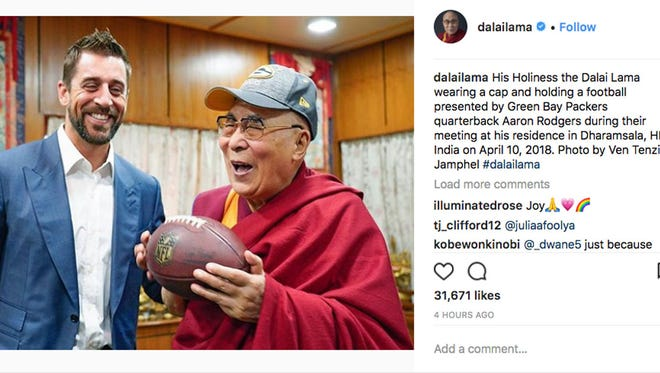 A photo posted on the Dalai Lama's Instagram account early Tuesday shows him meeting with Green Bay Packers quarterback Aaron Rodgers.
