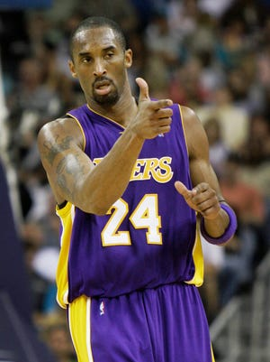 Los Angeles Lakers guard Kobe Bryant points after hitting a 3-pointer in the second half of an NBA basketball game against the New Orleans Hornets in New Orleans on Friday, March 23, 2007.
