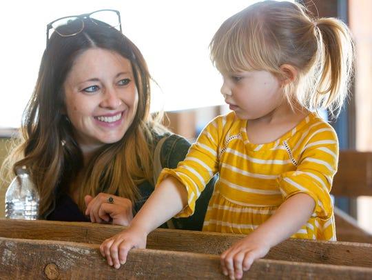Ava Slavec, 2, and her mom Shonda, both of Las Cruces,