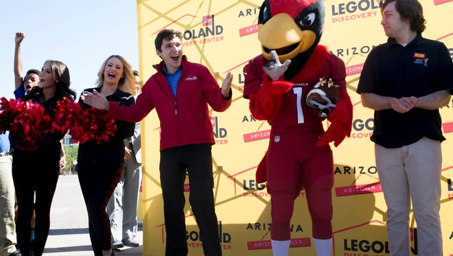 Alec Posta counts down the unveiling of University of Phoenix Stadium replica made from Legos, March 28, 2016, at the University of Phoenix Stadium, 1 Cardinals Drive, Glendale.