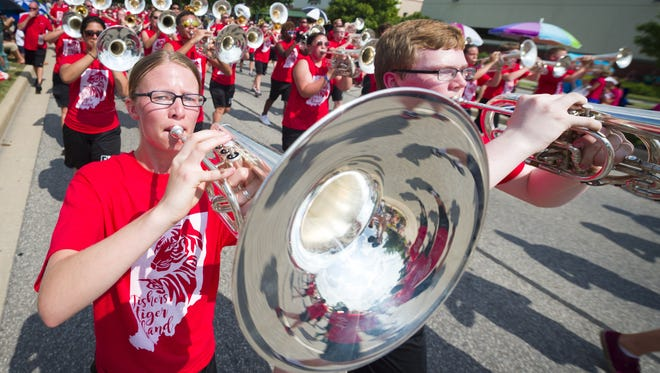 Katie Randall performs with the Fishers High School marching band during Sunday's Fishers Freedom Festival parade.