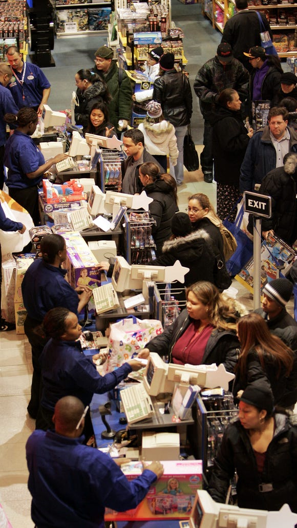 Shoppers make purchases on Nov. 23, 2007, at the ToysÒRÓUs