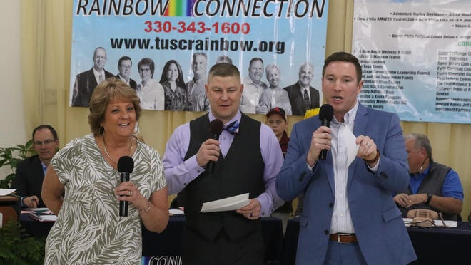 Carmel Haueter, Chris Lane and Steve Van Horn work during an auction session at the Rainbow Connection Telethon at Tuscarawas Central Catholic High School in early March.