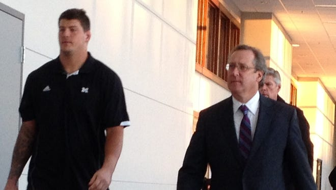Taylor Lewan, left, and attorney John Shea at 15th District Court in Ann Arbor on Thursday, Oct. 30, 2014.