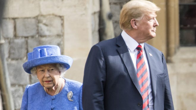 President Donald Trump and Queen Elizabeth II inspect a Guard of Honour at Windsor Castle on July 13, 2018 in Windsor.