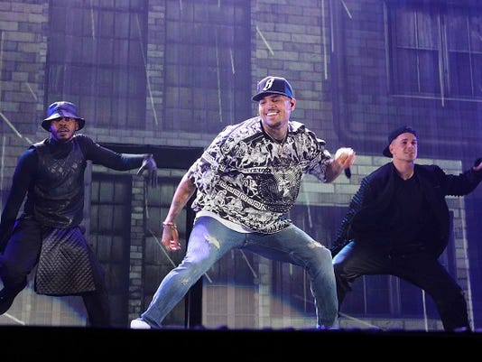 FILE - In this March 2, 2015 file photo, Chris Brown performs during the Between The Sheets Tour at Philips Arena in Atlanta.