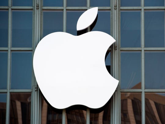 This file photo taken on Sept. 7, 2016. shows the Apple logo on the outside of Bill Graham Civic Auditorium in San Francisco.