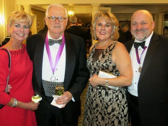 Rose and Ron Weems, Denise and Brian Landry at Krewe Justinian Royalty Dinner.